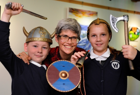 Vikings Day at Hanse House, King's Lynn, pupils from Whitefriars School, LtoR, Stephen Barker (10), Nicky Mortlock (event organiser), Vilma Endriukaityte (10)